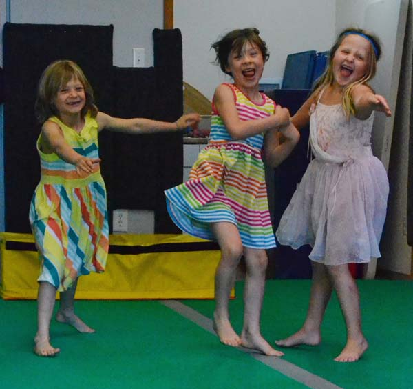 Lilly and Nella Belcher and Sophia Marrone get at little silly at the Twisp Gym. Photo by Laurelle Walsh