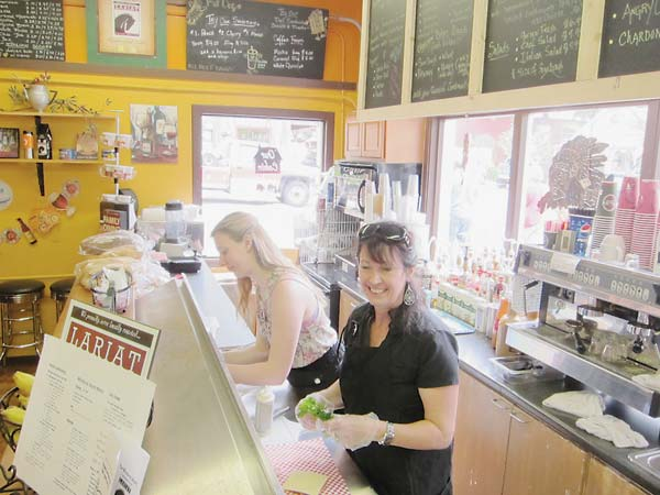 Lucinda Bowers, foreground, and her daughter Olivia were kept busy serving customers at the Winthrop Store last weekend. Photo by Don Nelson
