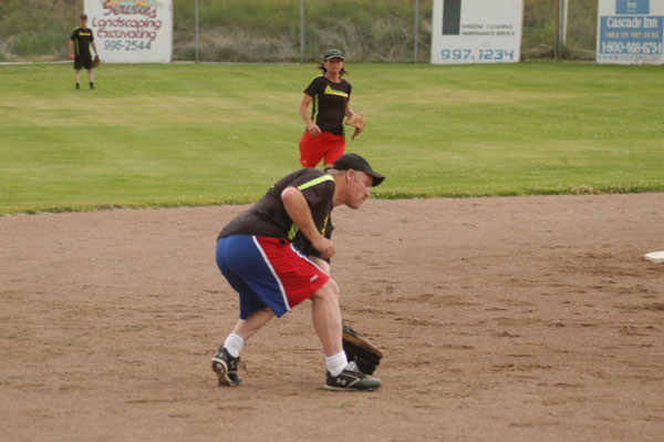 Shortstop Paul Budrow on the Evergreen IGA B team fields a grounder during the first game of a doubleheader against the IGA A team last Monday (June 16). Photo by Mike Maltais