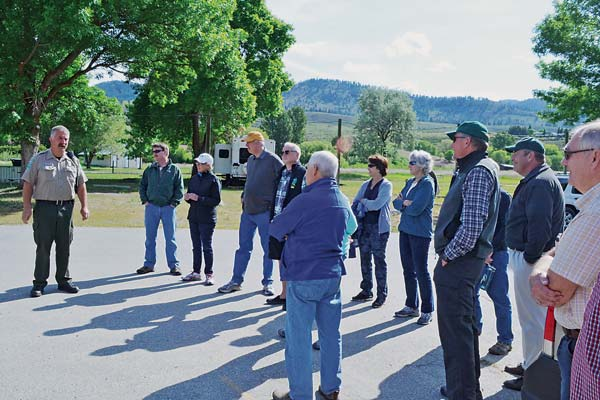"""Pearrygin Lake State Park Manager Rick Lewis, left, presents """"a day in the life of a park"""" to visiting Washington State Parks commmissioners. Photo by Laurelle Walsh"""