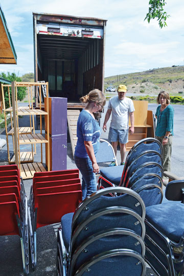 Volunteers Lillian Foster, Steve Robinson and Alison Philbin move furniture out of the Community School's former digs in Winthrop. Photo by Laurelle Walsh