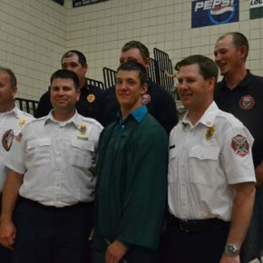 Class of 2014 graduate and volunteer firefighter Shane Higbee stands among his colleagues, Fire District 6 division chiefs Keith Comstock and Brian McAuliffe and Assistant Chief Cody Acord.Photo by Laurelle Walsh