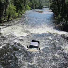 Paul Picolet's Ford F-150 rolled into the Chewuch River in Winthrop at about 11 a.m. on May 31. It had been parked in a lot behind the Tenderfoot store. Picolet's dog, Jessie, was in the bed of the pickup and rode out the truck's plunge into the river. Photo by Don Nelson