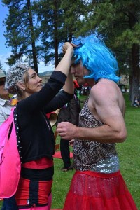 """Dresser"" Laura Gunnip assists competitor Clark Youmans in the Drag King/Queen race. Photo by Laurelle Walsh"