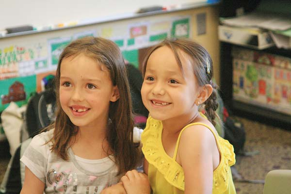 Methow Valley second grader Sapphire Ekblad, left, and Paschal Sherman first grader Syriana Marchand share a love of animals—they have five dogs, one  hamster, three chickens, one gerbil and a horse between them. Photo by Marcy Stamper