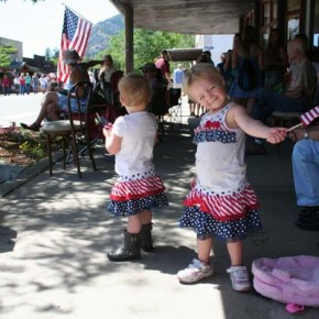 A good flag wave takes practice, according to Koda and Madelynn Budrow. Photo by Darla Hussey