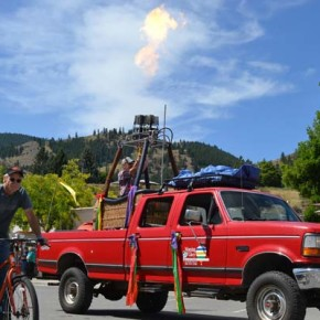 Dwight Filer rides his bike alongside Kurt Oakley who fires his hot air balloon burner. Photo by Laurelle Walsh