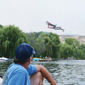 Campers at Silverline Resort were notified that a Level 2 evacuation order was in effect for Pearrygin Lake, but most elected to stay. Families watched from the shoreline as air tankers scooped up water from the lake. Photo by Laurelle Walsh