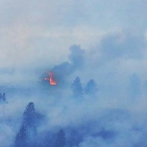 A structure engulfed in flames above Rising Eagle Road was visible from across the valley. Photo by Laurelle Walsh