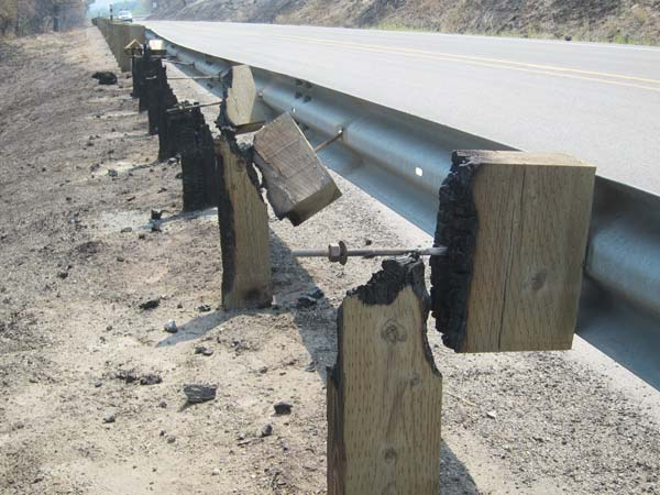 The Rising Eagle Road fire jumped across Highway 20 and charred guard rail posts near Methow Valley United Methodist Church. Photo by Don Nelson
