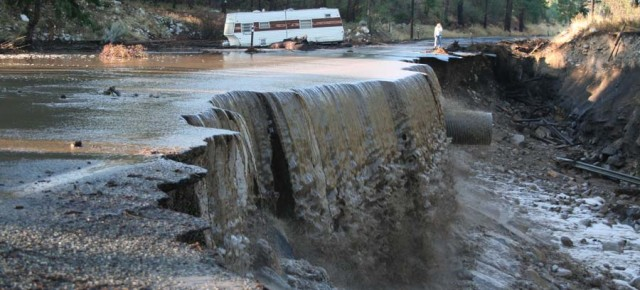 Floods, slides cut swath of damage after torrential storm