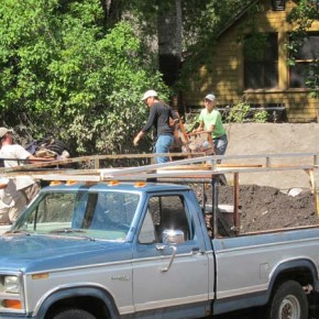 Volunteers carried furniture and other belongings out of the Elk/Lewis home. Photo by Don Nelson