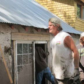 Bob Elk, center, talks to some of the volunteers helping at the Elk/Lewis home. Photo by Don Nelson
