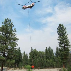 A helicopter fighting the Rising Eagle Road Fire dipped its water bucket in the Methow River. Photo by Don Nelson