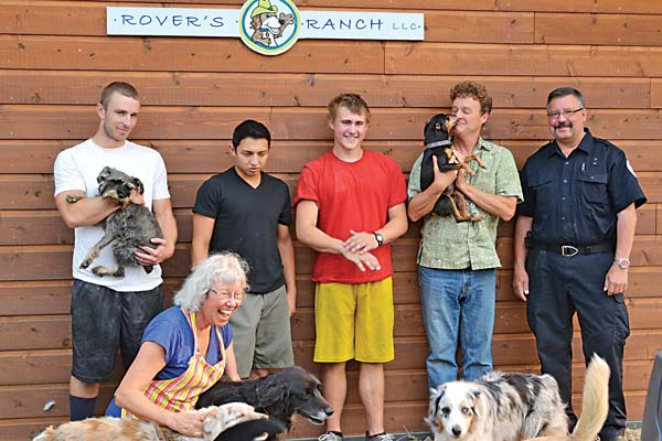 Some of the crew that helped evacuate Rover's Ranch dog boarding on Aug. 1 were, from left, Liberty Bell High School football coach Brian Wilbur, football players Jose Dominguez and Jacob Whitney, proprietor Patrick Heim, Aero Methow paramedic Russ White and proprietor Kathryn Heim, front. Photo by Laurelle Walsh