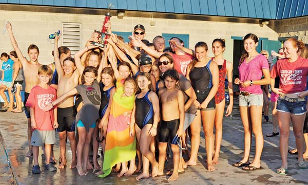 The 2014 Killer Whales swim team showing off the trophy they'd just won. Photo by Ashley Lodato