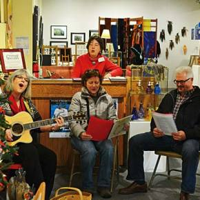 "Margaret and Dan Birdsey, of Preston, Washington, stopped by the Winthrop Gallery last Saturday (Dec. 13), and joined songstress Lauralee Northcott and gallery host Katie Swanson for some good old-fashioned Christmas carols. The Birdseys were on a ""weekend getaway,"" celebrating their 33rd wedding anniversary in the Methow with a stay at Sun Mountain Lodge. Northcott will be at the gallery for more caroling on Saturday (Dec. 20) from 1-2 p.m. Photo by Laurelle Walsh"