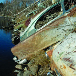 Project will turn junked cars used to stabilize river bank into public art