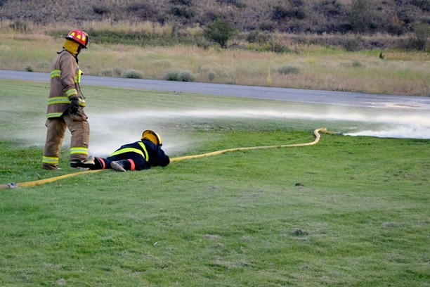 "District 6 volunteers practice a ""wild hose"" drill during training. Photo by Laurelle Walsh"