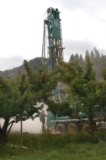"""A test well was drilled in the orchard behind Hanks' Harvest Foods in Twisp last week as part of the Methow Valley Irrigation District's """"Instream Flow Improvement Project."""" Drilling was suspended this week because of the federal government shutdown. Photo by Ann McCreary"""