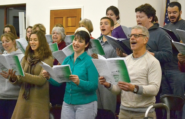 Members of the Cascadia Chorale rehearse for the Dec. 10-11 Holiday Concert performances, under the direction of Dana Stromberger. The group is working on a dozen songs for the event. Photo by Laurelle Walsh