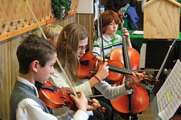Zachary Strong, Lena Nelson and Aidan Catlin of the Pipestone Youth Orchestra played last week at the Methow Valley Senior Center. Photo by Marcy Stamper