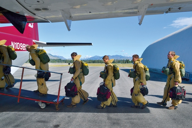 Veteran smokejumpers and trainees loaded into a twin-engine turboprop for practice jumps. Photo by Laurelle Walsh