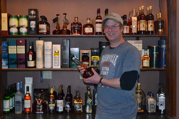 """Dave Swenson displays some of the """"top-shelf"""" spirits offered by the Wine Shed. Photo by Laurelle Walsh"""