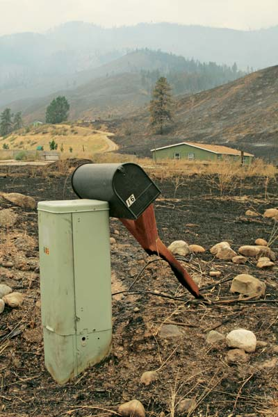 The fire jumped Highway 153, sparing many homes and barns surrounded by green space, but leaving its mark on the once-mundane objects of daily life. Photo by Marcy Stamper