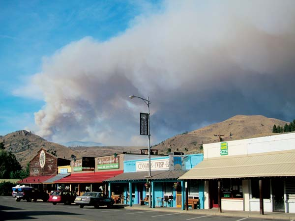 Smoke from the Cougar Flat Fire boiled over Twisp last Thursday. Photo by Don Nelson