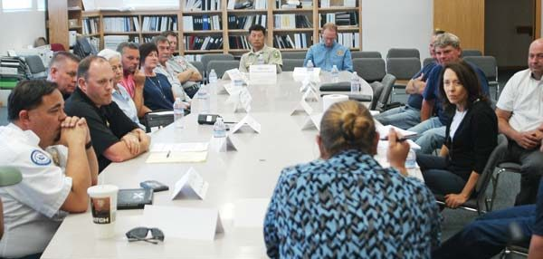 Photo by Ann McCreary Sen. Maria Cantwell, far right, listens to Okanogan County officials and responders during a roundtable discussion last Saturday.
