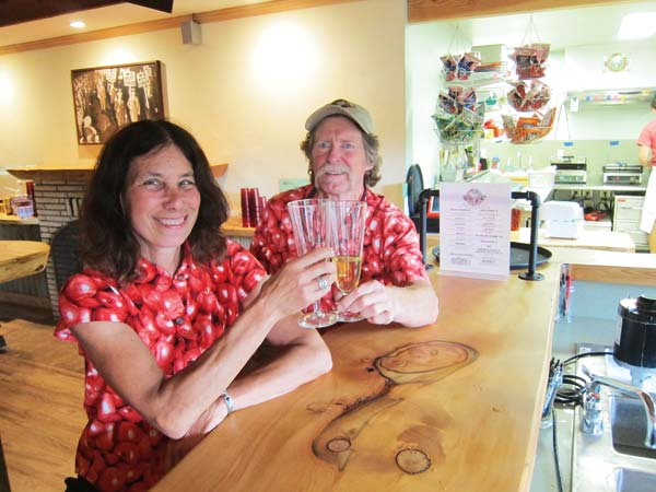 Photo by Don Nelson Lynne and Richard Wasson sample the offerings at their recently opened Methow Valley Ciderhouse.