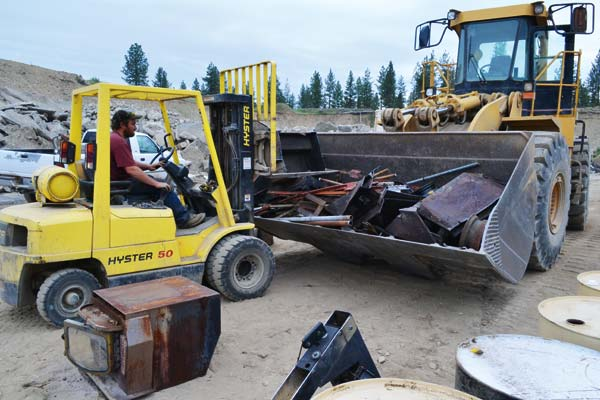 File photo by Laurelle Walsh Cascade Concrete provides both the location and the heavy equipment for the annual Metal Drive, coming up on May 2–3.