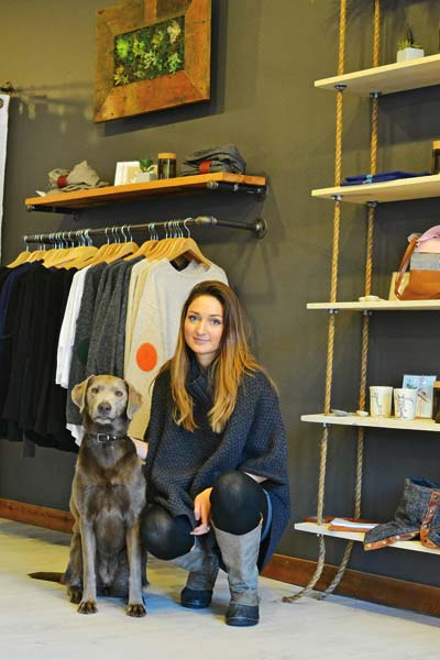 Owner Kary Brennan and her dog, Cinder, greet customers at Winthrop's newest boutique – Gathered. Photo by Laurelle Walsh