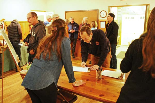 Photo by Don Nelson Alah Fahnestock signed in at a community meeting last week where leaders of the Methow Headwaters Campaign gave an update on the organization's progress.
