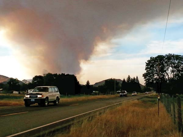 Photo by Darla HusseyPhoto by Darla Hussey At 5 p.m. Wednesday night, the smoke plume towered over the non-stop line of cars leaving the Methow Valley along Highway 153.
