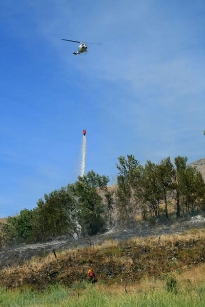 Photo by Marcy StamperA helicopter dropped water on a fire on the south side of Highway 20 near Beaver Creek.