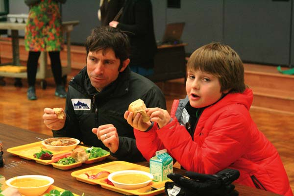 Photo by Marcy Stamper James DeSalvo and his son Malloch shared a lunch of local and home-grown ingredients at the school last week.