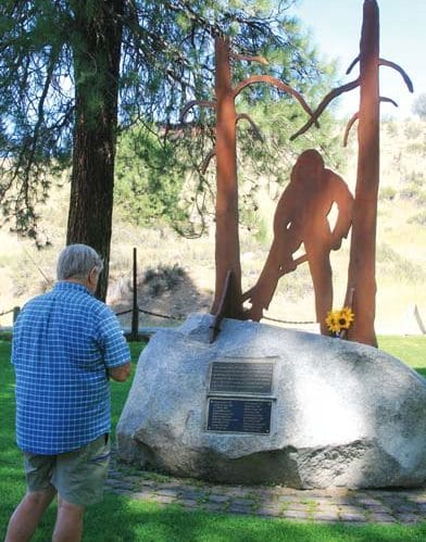 Photo by Marcy Stamper People paid tribute to the memorial in Mack Lloyd Park that honors all firefighters who have died in wildfires in the Methow Valley — 20 losses going back to 1929.